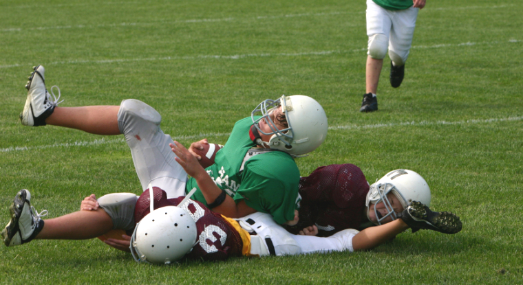 Photo of youth football tackle and concussion