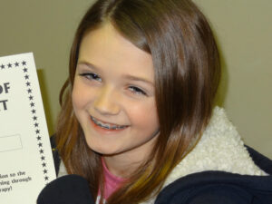 Kendall's reading, writing, and math scores have improved with vision therapy.